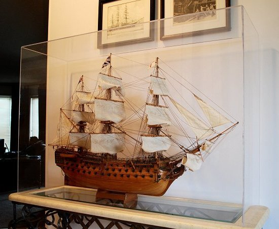 HMS Victory    model under a large acrylic cap with clear beveled edges.